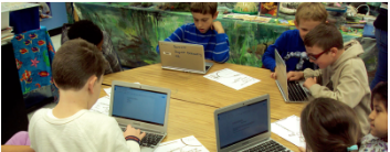 Image of Students Collaborating Using a Device